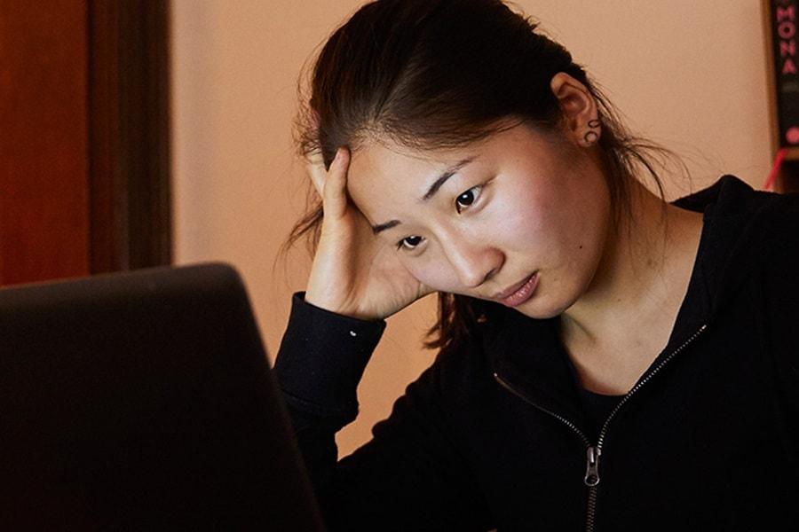 girl-in-black-jumper-on-laptop.jpg